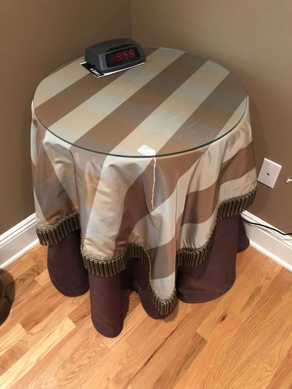 Round table with striped fabric table cloth skirt